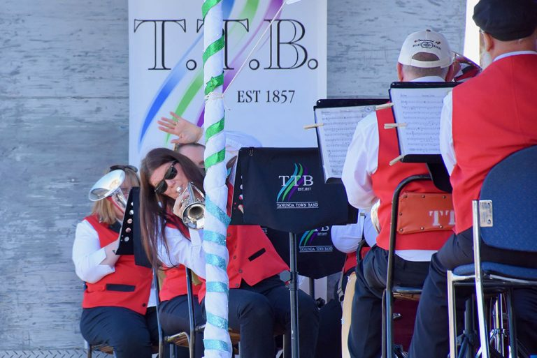 Tanunda Town Band's Alicia Lüdi-Schutz gives a wave as she plays on the band's truck.