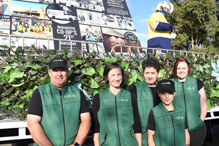 Andrew Swyghuizen, Charlotte Williams, Julie Noack, Bryce Wilds and Julia Vivian part of the Co-op float.
