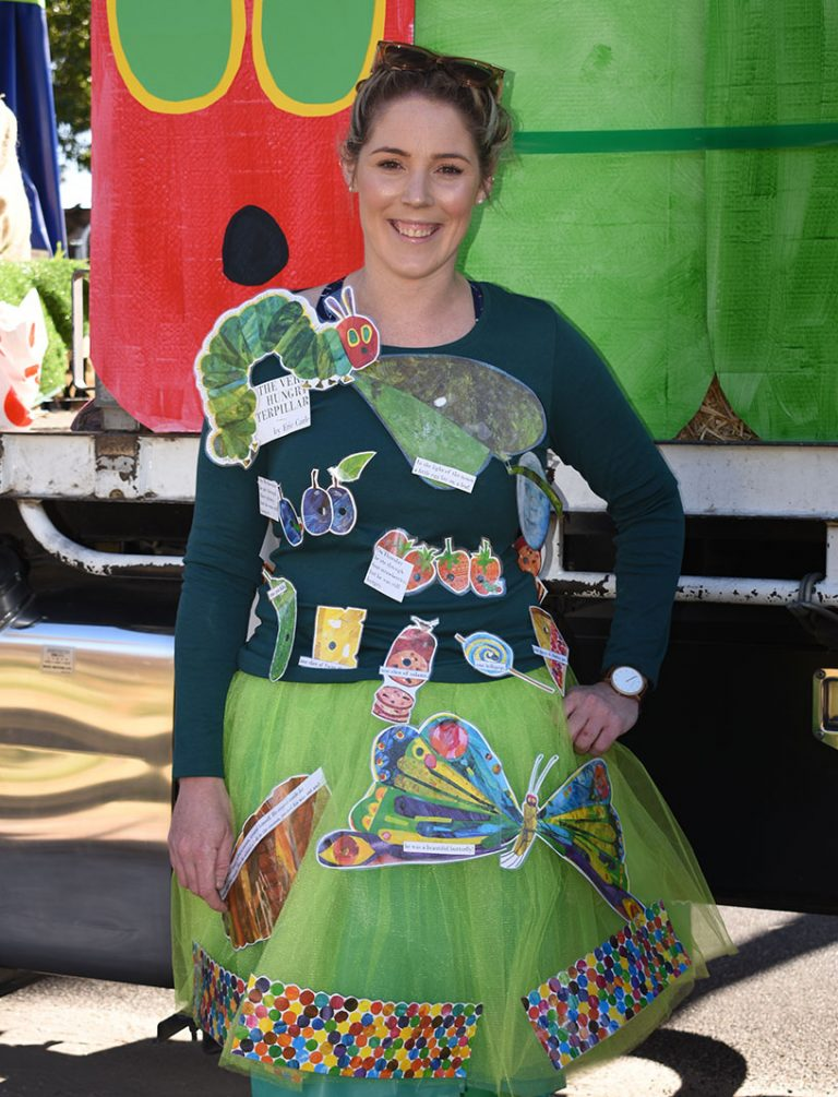 Laura Flowers, dressed as 'The Very Hungry Caterpillar' storybook, part of the Stepping Stone float.